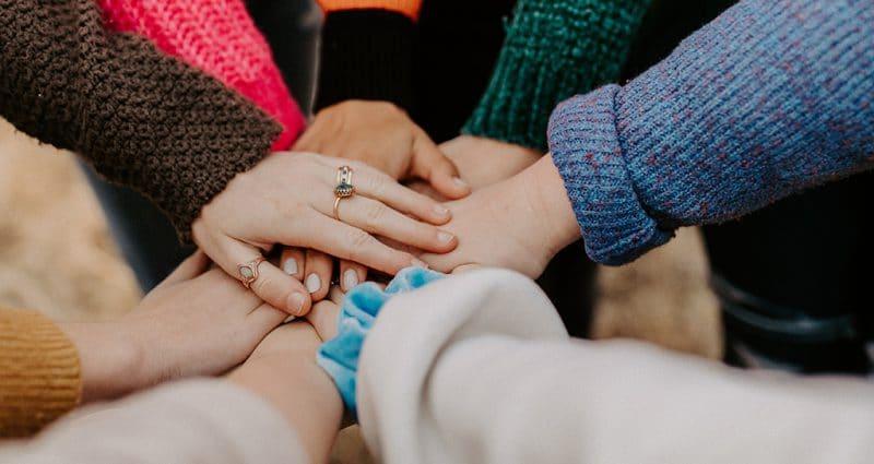 Changemakers hands together