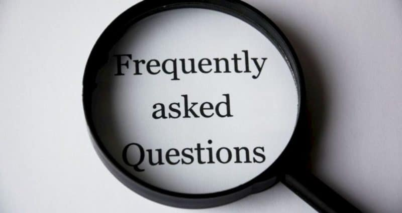FAQs image on a magnifying glass