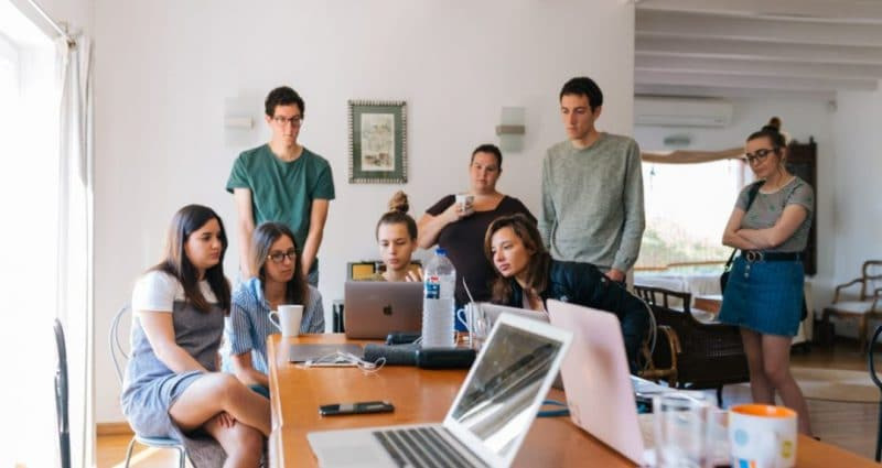 group of people watching on laptop